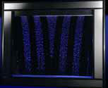 A dark blue Aquagraphics water wall in a booth
