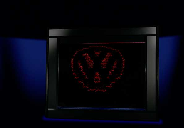 An Aquagraphics water display screen in a booth featuring the VW logo
