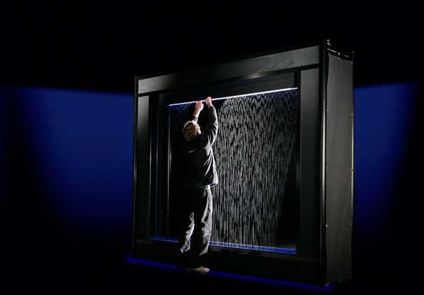Setting up an Aquagraphics bitfall water screen in a booth